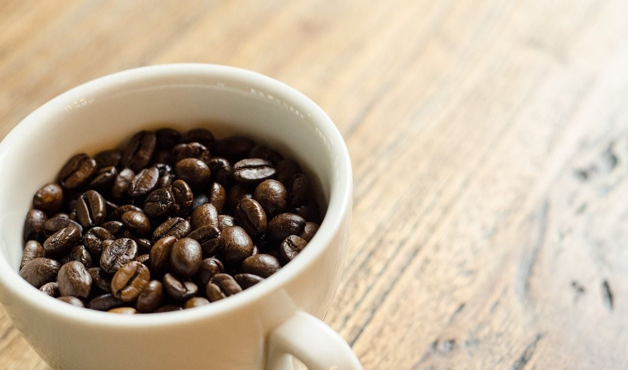 There's approximately 6 mg of caffeine in a roasted coffee bean.
