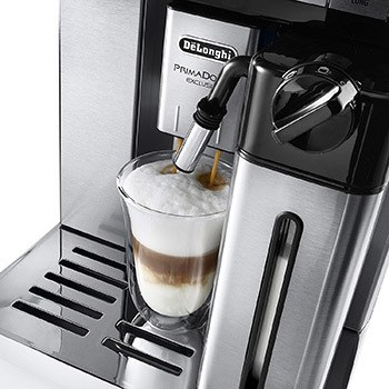a super-automatic espresso maker in action new