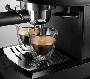 an espresso maker in action
