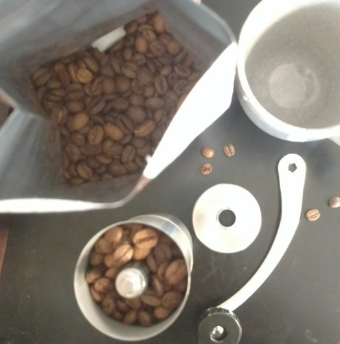 making coffee with coffee grinder