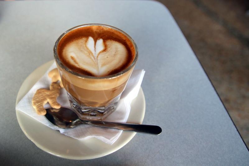 Cortado coffee with animal crackers