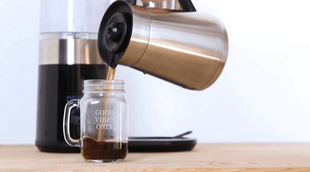 Pouring Coffee From Coffee Maker
