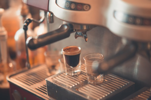 an espresso maker making a shot