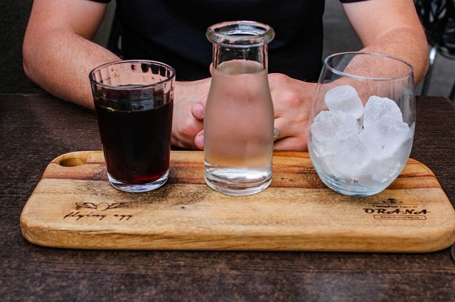 cold brew coffee on a plank