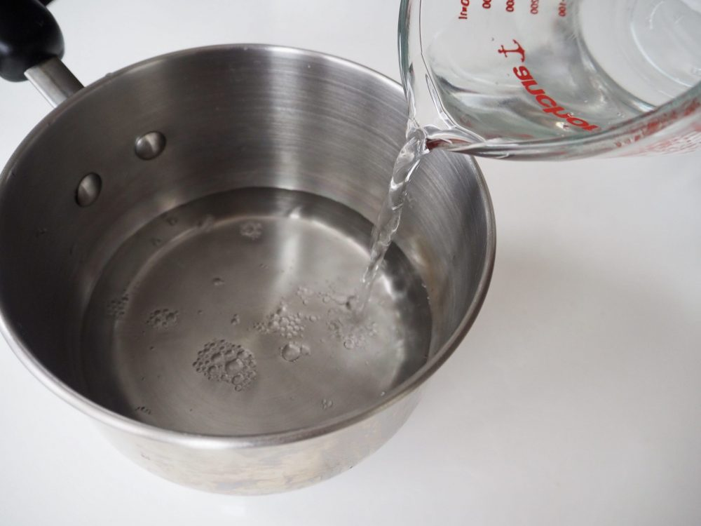 Add water and salt to the pot.