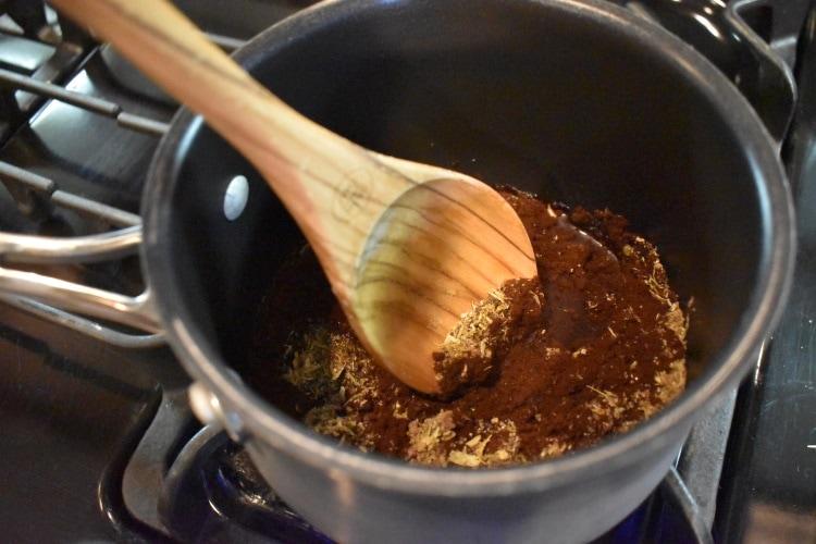 A pan with coffee & ground cardamom