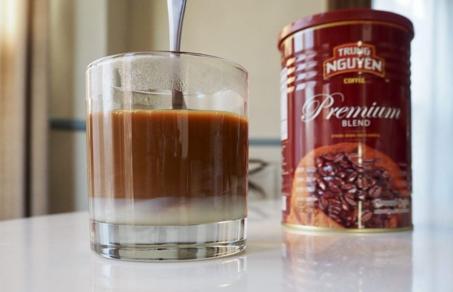 Stirring Vietnamese coffee