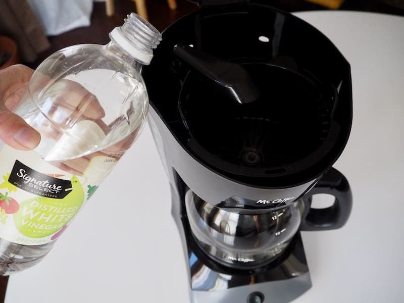 Pour vinegar into Mr. Coffee