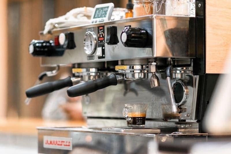 used espresso machine pulling a shot