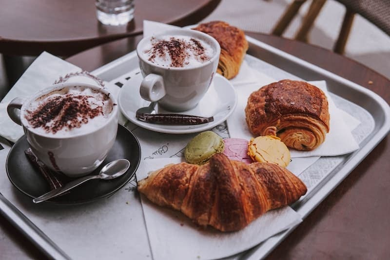 French coffee with croissants and macarons