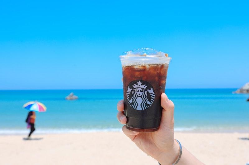 Starbucks caramel iced coffee on the beach