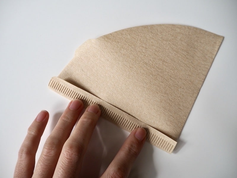 folding a brown Hario V60 paper filter