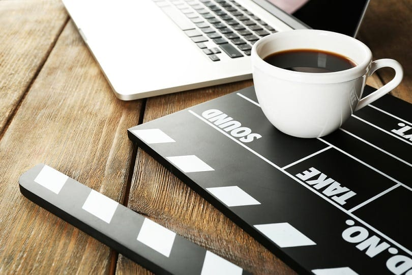 Movie clapper with cup of coffee_Africa Studio_shutterstock