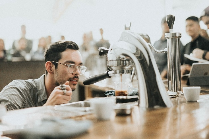 barista looking at dripping coffee