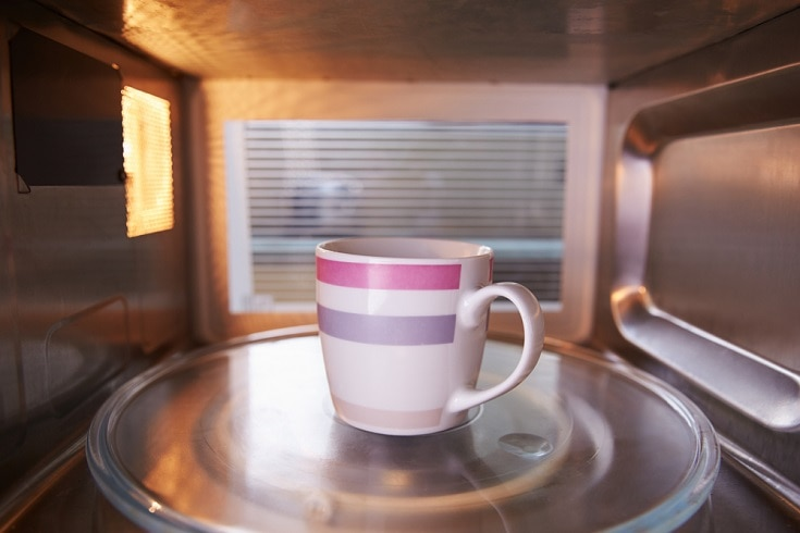 Coffee inside microwave oven_Shutterstock_Monkey Business Images
