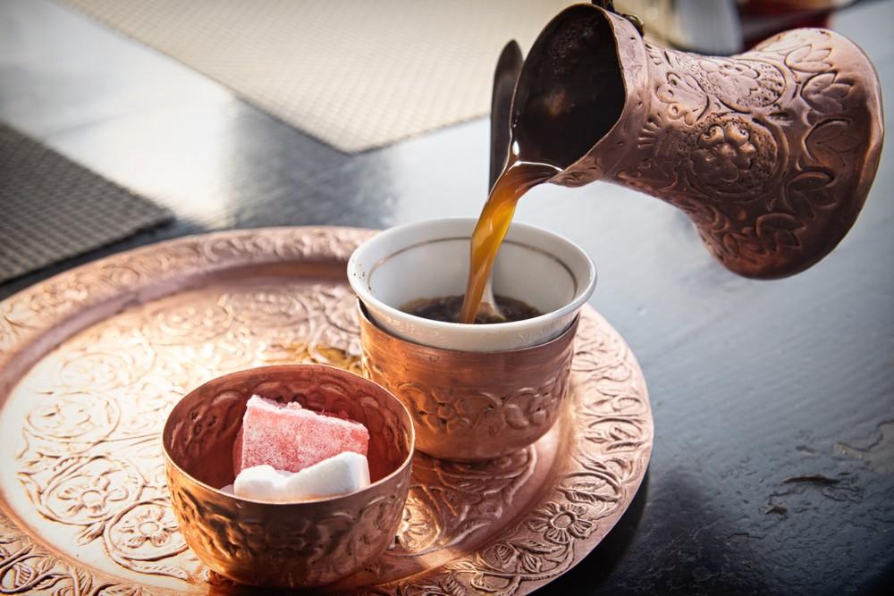 Bosnian coffee pouring copper pot