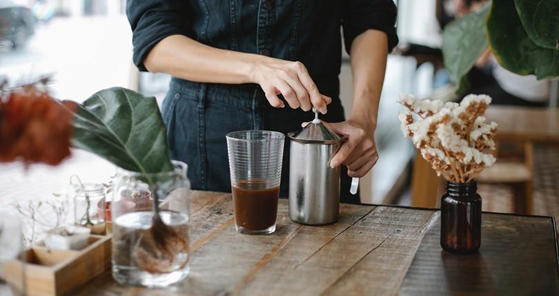 barista preparing iced chocolate coffee