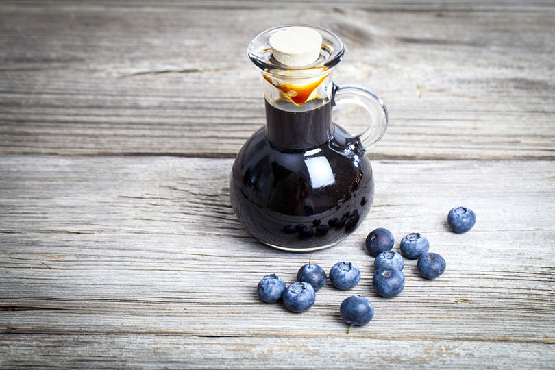 blueberry syrup in glass bottle