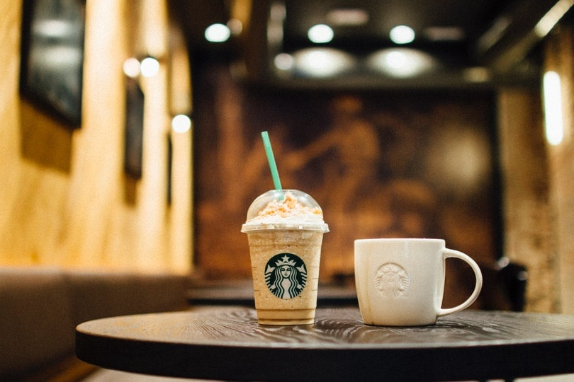 starbucks frappe and cup on table