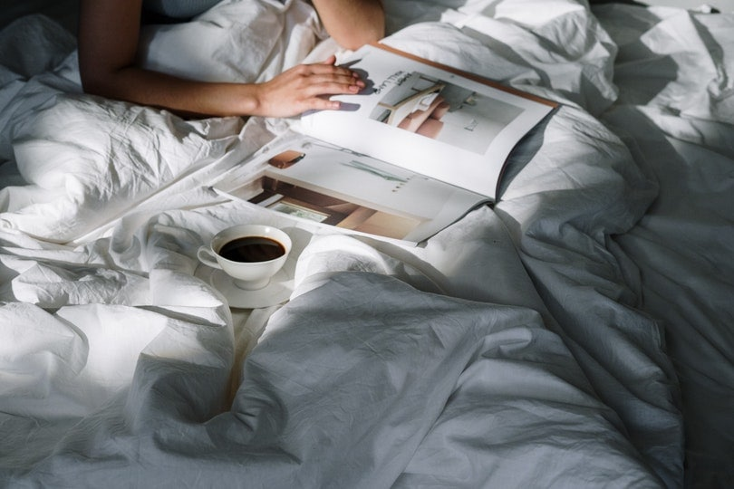 a cup of coffee on bed