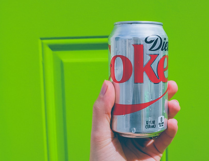 hand holding a can of diet coke