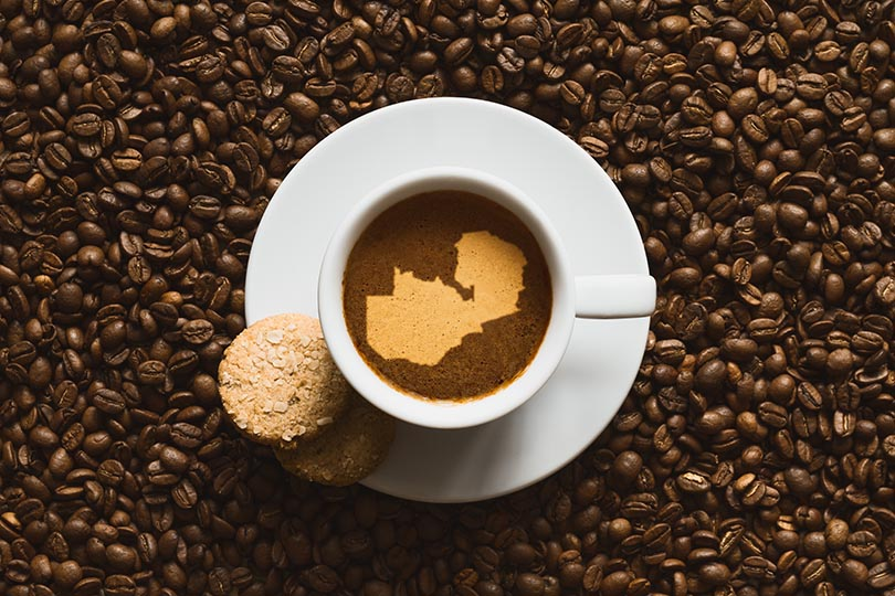 hot coffee beverage with map of Zambia