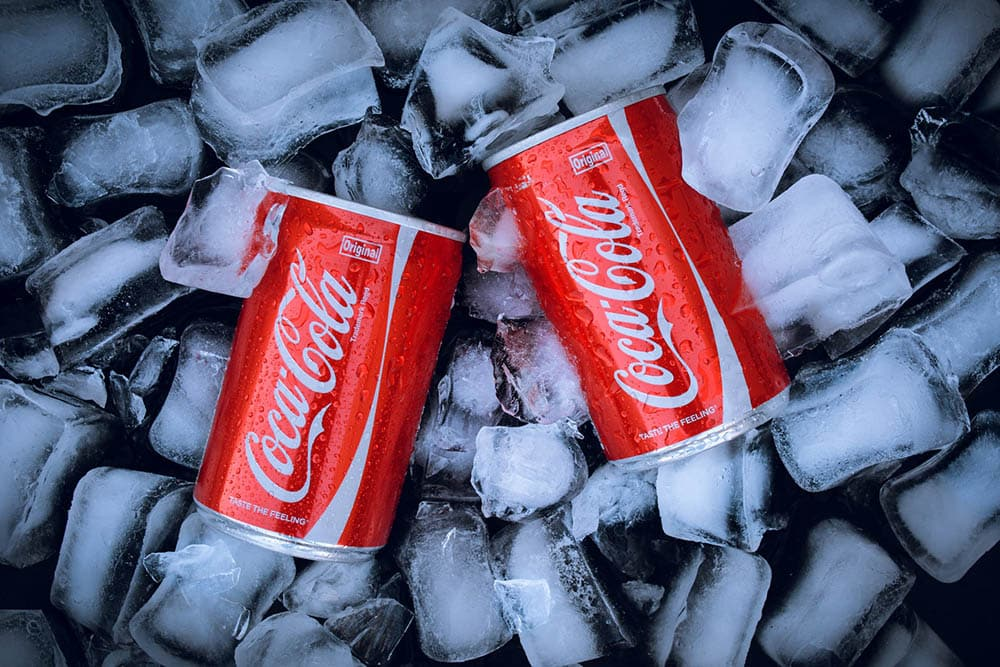 two cans of coke
